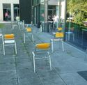A test parcour made of multiple, randomly arranged, chairs with yellow markers attached to their backside.